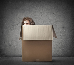 bigstock-Man-hiding-in-a-box-38591461